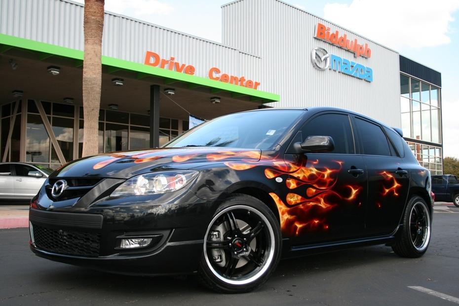 Mazdaspeed3 in front of dealership
