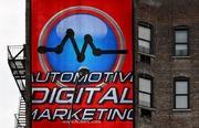 Automotive Digital Marketing Logo on Building
