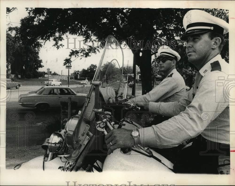 Police on motorcycles watch Houston traffic