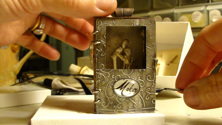 an automaton pendant (action shot):  did I request thee, Maker, of my clay to mould me?