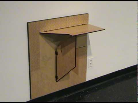Folding furniture created by Christy Oates. MFA thesis show, laser cutting.