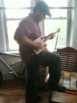 Dr. Ryan playing his new 3-string Cigar Box Guitar, The Ray-Ray