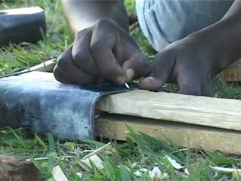 How to make a tin can guitar - Sotho Sounds