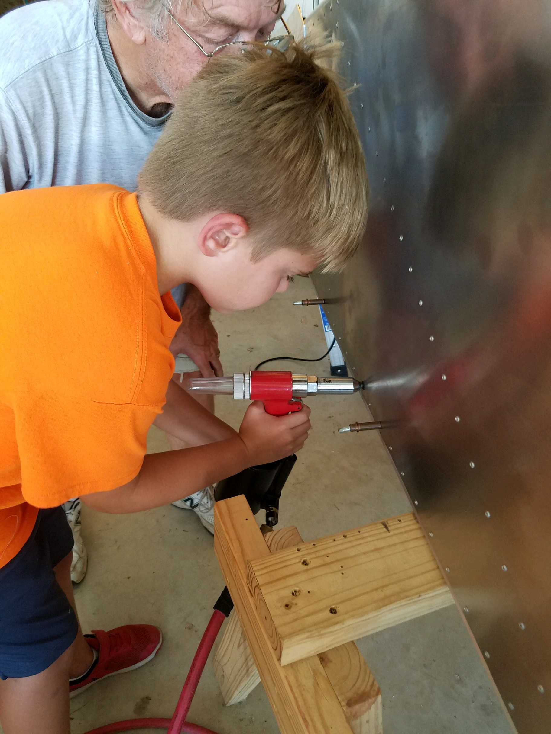 Zenith Cruzer---Alex pulling his first rivet!