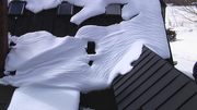 Snow on a black Roof