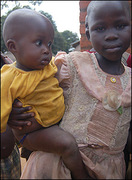 Uganda war -Child in charge of another child