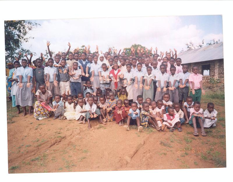 Orphan children from various nursery, primary and secondary schools in Kinango District paused for a joint photograph appealing for assistance to better their education and feeding programme.