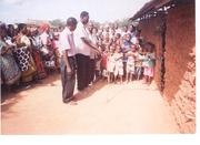 Its a happier moment as the founder of Copi NGO in Kenya, Robert Kasena cuts the tape to official open Kadzitsoni Orphaned day care centre as the orphans themselves closely watch.
