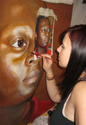Midway through a portrait painting on wood