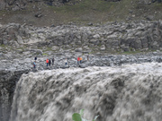 People are tiny near the giant Dettifoss, Europe's most powerful waterfall