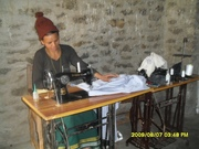 CDC Women sewing clothes after taking training