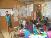 CDC Women reading in the school with children