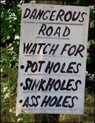 Capture Dangerous Road sign...