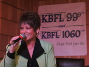 Anita singing for the radio station KBFL
