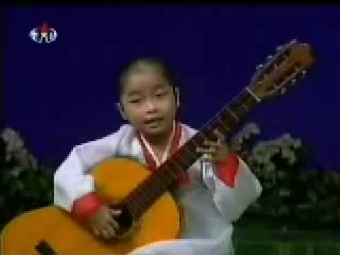 Must See!  Little North Korean Girl Playing Guitar