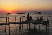 Pesca al tramonto.