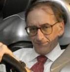 Bill's formal speaker's photo in F1 race car