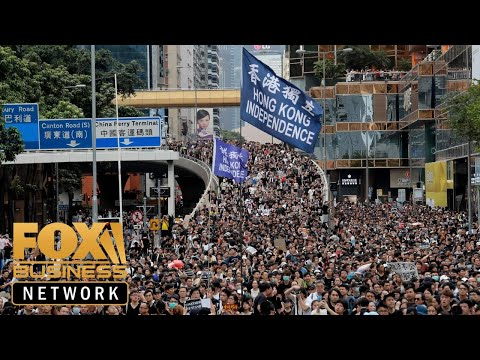 Hong Kong protesters held American flag, sang US national anthem
