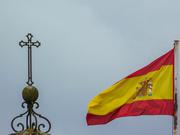 Cross and Flag against a Cloudy Sky