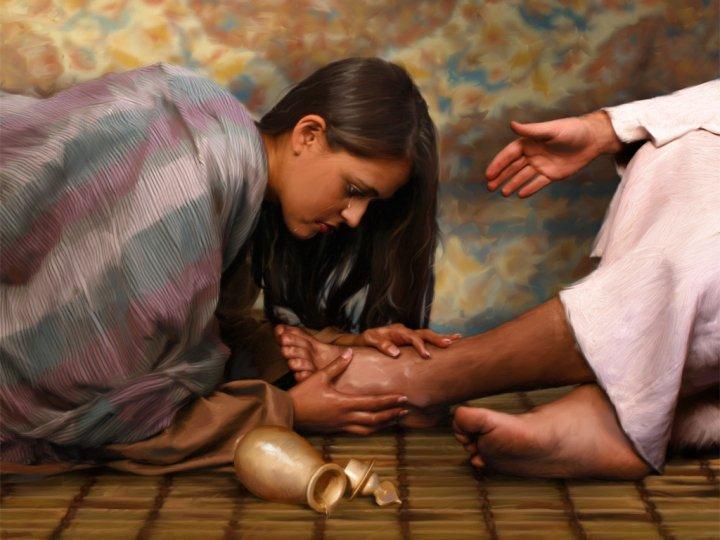 Mujer a los pies de Jesùs