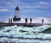 Ludington lighthouse, people and waves