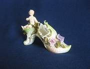 Vintage Ceramic High Heeled Decorative Shoe Featuring a Cherub