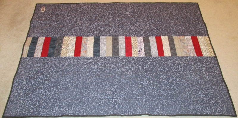 Strip quilt back made for Project Linus.