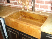 Rustic farm sink with acid stained counter
