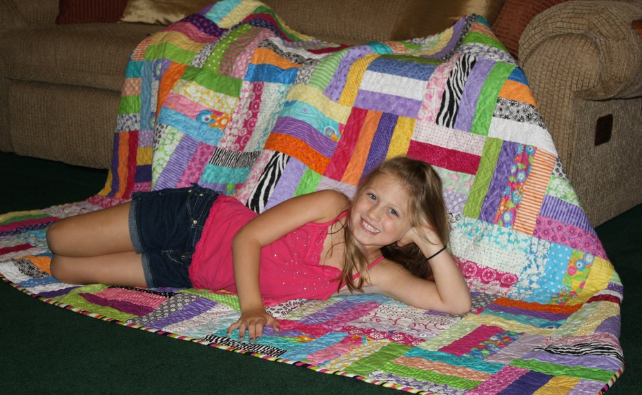 My granddaughter and her quilt.