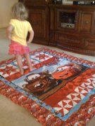Anna dancing on her Cars quilt