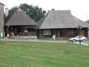 The classic, old wooden houses in the center of Pruchnik arranged with wooden roofs, shingles