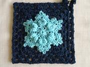 a snowflake on a granny square