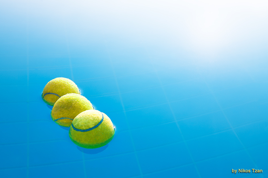 Three tennis balls on vacation