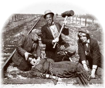 Obama, Pelosi and Reid tying a damsel in distress to the railroad track