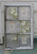 Vintage lace added to the back of this old window while pretty roses were painted on the front. Gorgeous reuse!