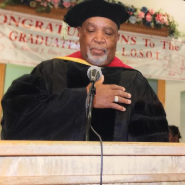 Dr. Benoit Praying