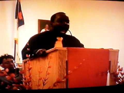 minister LaMont Jones preaching At New Zion M.B.C