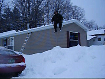 Husband jumping off roof into snow
