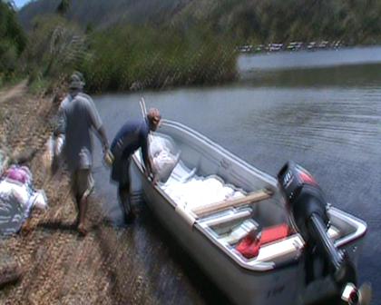 Rabi boys loading first Aid shipment at Koroko