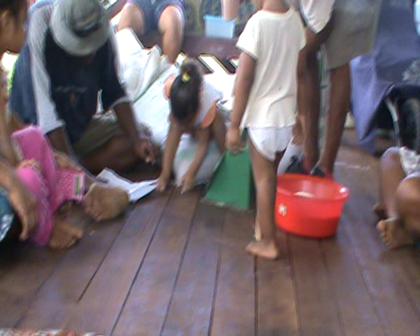Dividing Food rations SDA settlement Tabwewa Rabi