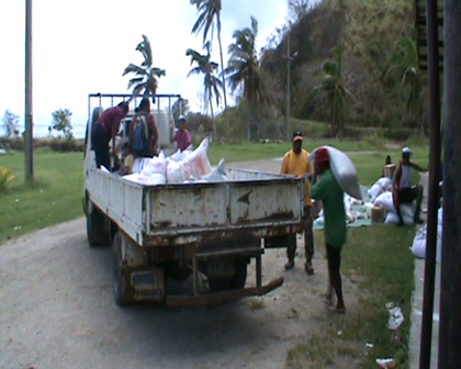 Loading lorry with Fiji food aid for village distribution