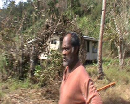 Bauro accepting food aid at Nasau settlement Rabi Fiji