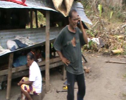 Tanara at Eritabeta talking to his children and family in Suva on satellite phone