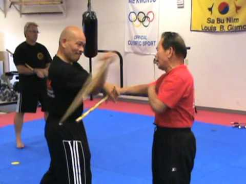Grandmaster of Eskrima, Atillo Balintawak WEAPONS sparring with student Virgil.