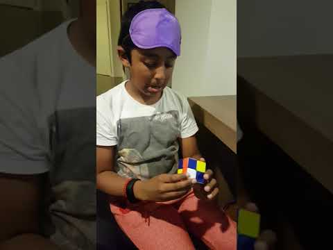 10 year old solving Rubik's cube blindfolded in 22 seconds