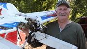 Layne Johnson with burned float plane.