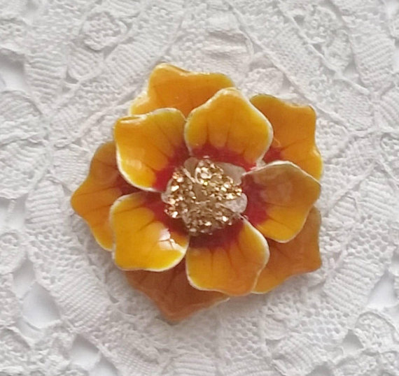 Vintage orange enamel brooch
