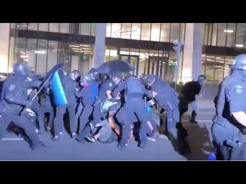 Police charged the Antifa shield wall hard, not holding back on beating the rioters with batons