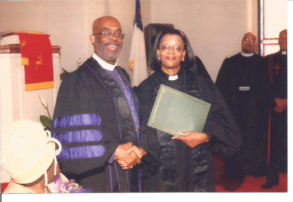 BISHOP HOLMES TAKES PICTURE WITH CONFIRMED ORDAINED ELDER REV. DR. MARTHA ANDREE' LEWIS AT END OF HOLY ORDERS CEREMONY IN PRESENCE OF THE TENNESSEE AME ZION CONFERENCE CHURCH CONGREGATION