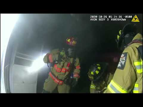 Body cam footage shows Bryan police, firefighters saving man from burning home